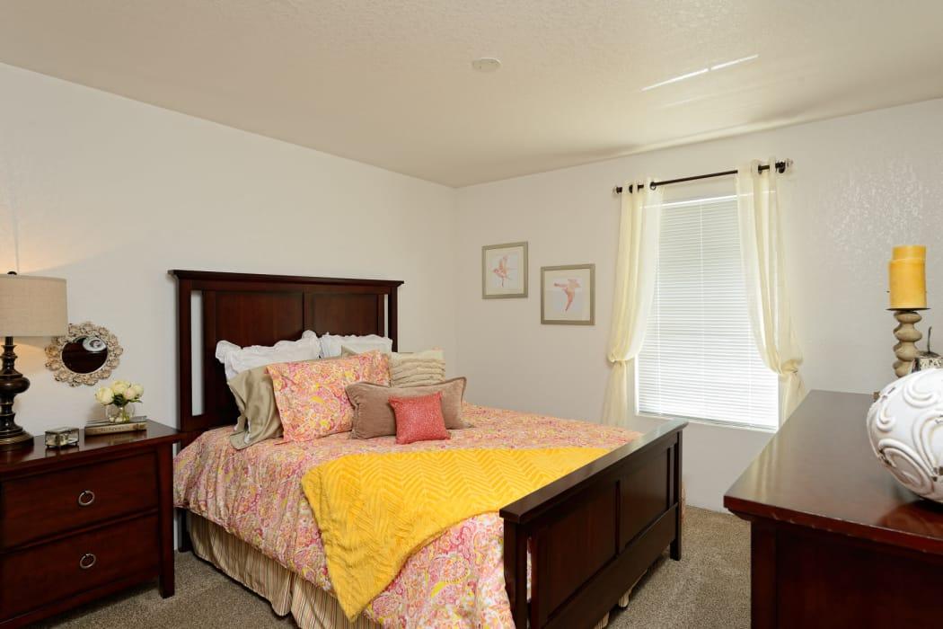 Well-lit bedroom at Acacia Park Apartments in El Paso, Texas