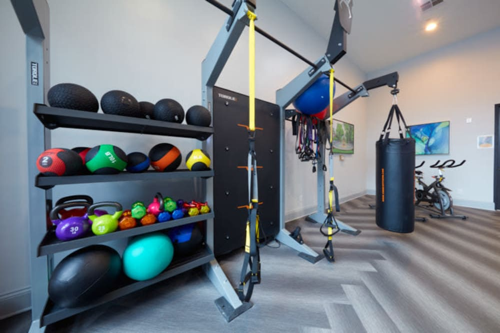 Fitness center at Trifecta Apartments