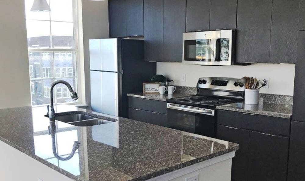 Stainless-steel appliances & granite countertops at Nexus Luxury Apartments in Virginia Beach, Virginia