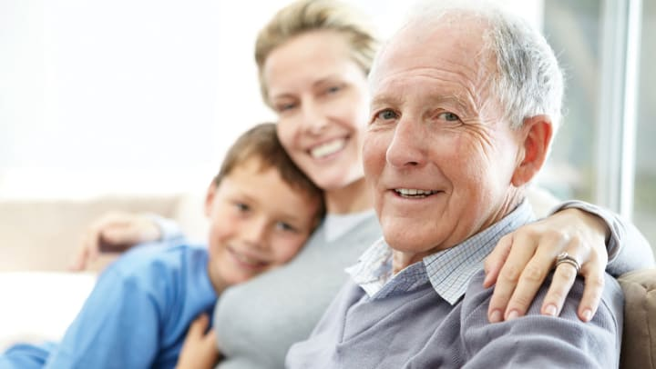 Elderly man enjoys time with his family.