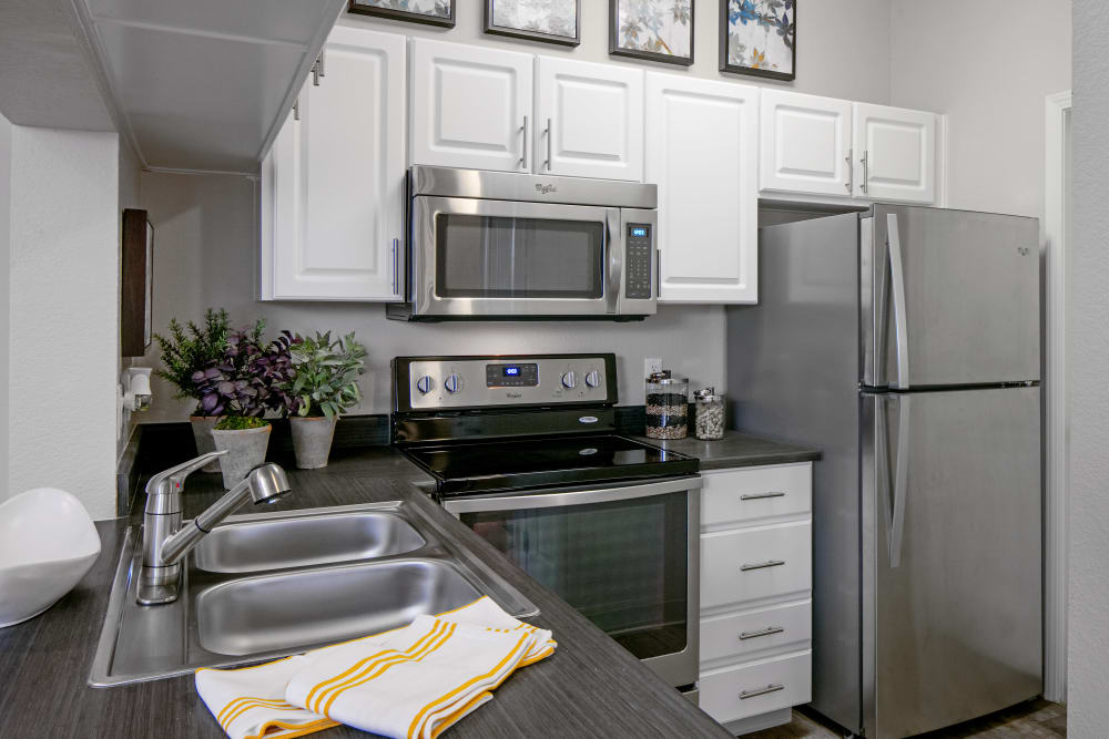 Apartment kitchen with stainless-steel appliances at Cortland Village Apartment Homes in Hillsboro, Oregon