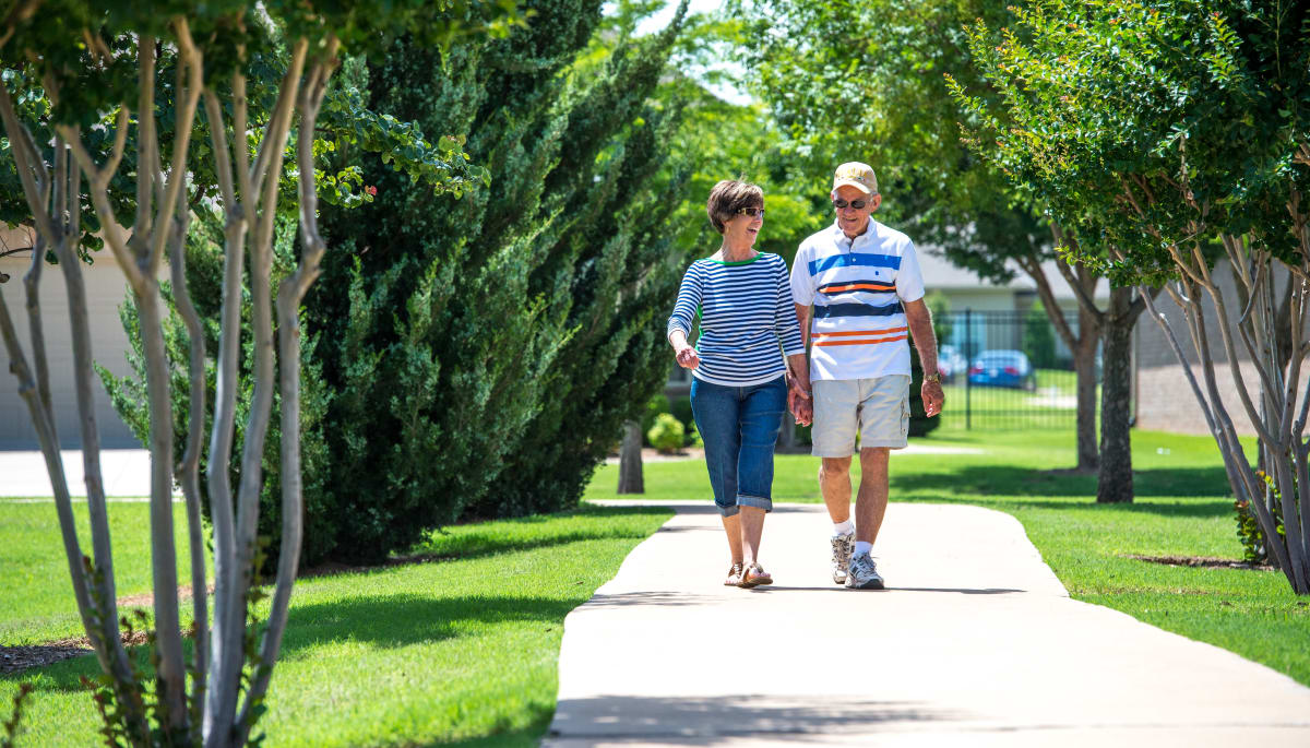 Two residents walking near Touchmark at Coffee Creek in Edmond, Oklahoma
