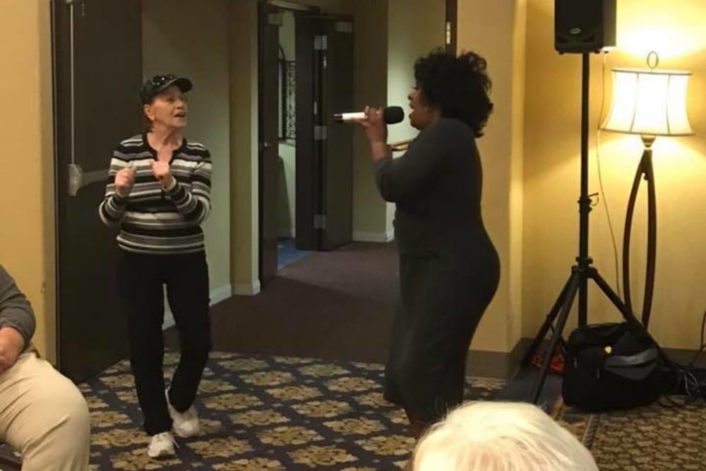 senior residents enjoying karaoke