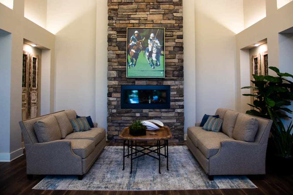 Fireplace lounge with sofas and chairs for visiting at Westminster Memory Care in Lexington, South Carolina