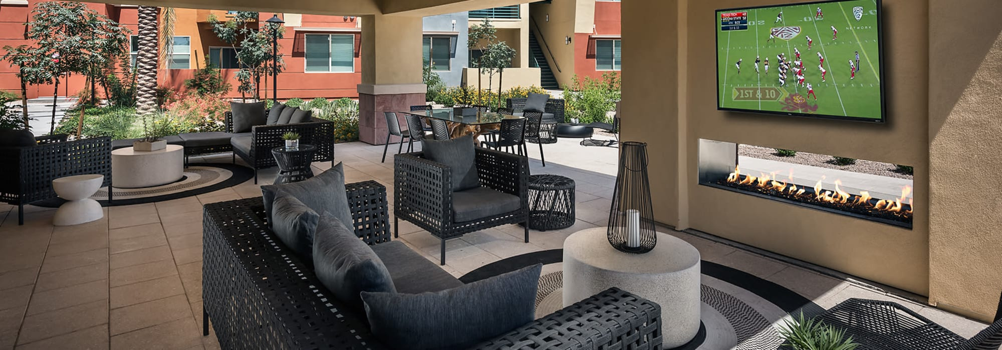 Community lounge with big screen televisions at Villa Vita Apartments