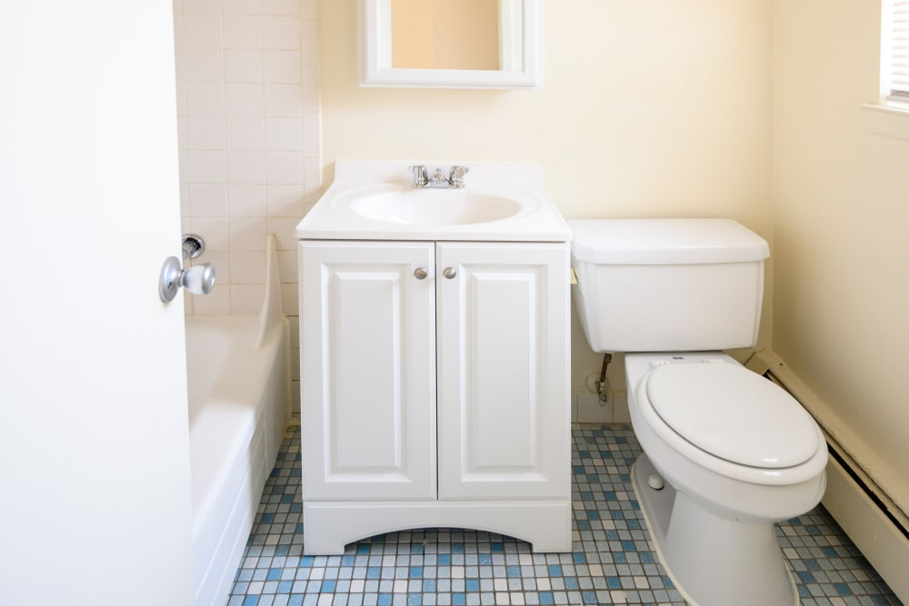Bathroom with light blue tile style flooring at 84-90 Essex Street in Hackensack, New Jersey