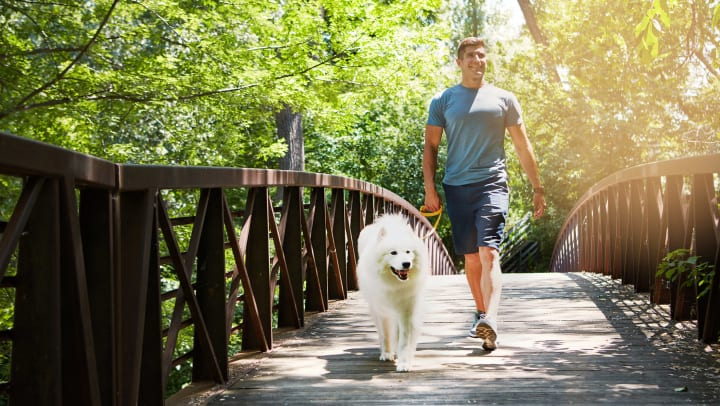 Resident and his dog out for a brisk trail walk near Olympus Katy Ranch in Katy, Texas