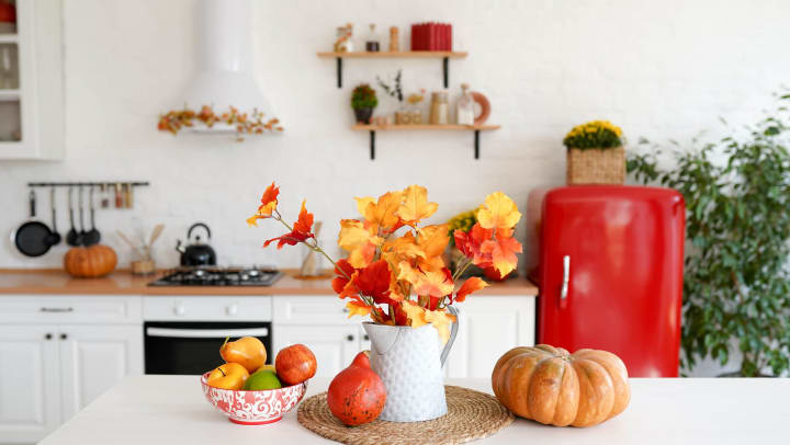 Cute fall center piece on a white table
