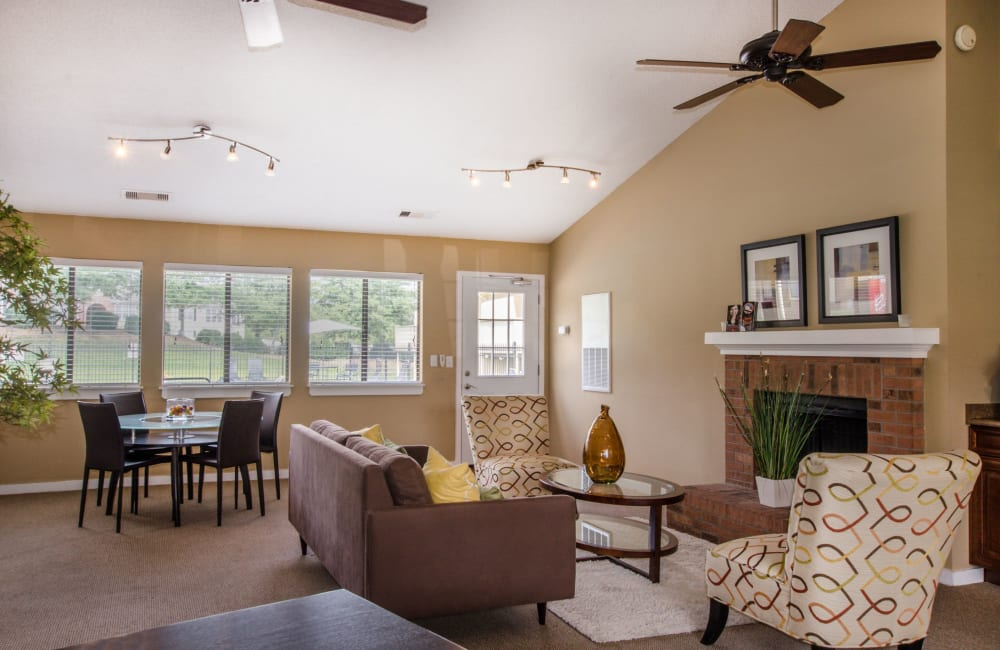 Clubhouse with a ceiling fan and a fireplace at Wexford Apartment Homes in Charlotte, North Carolina