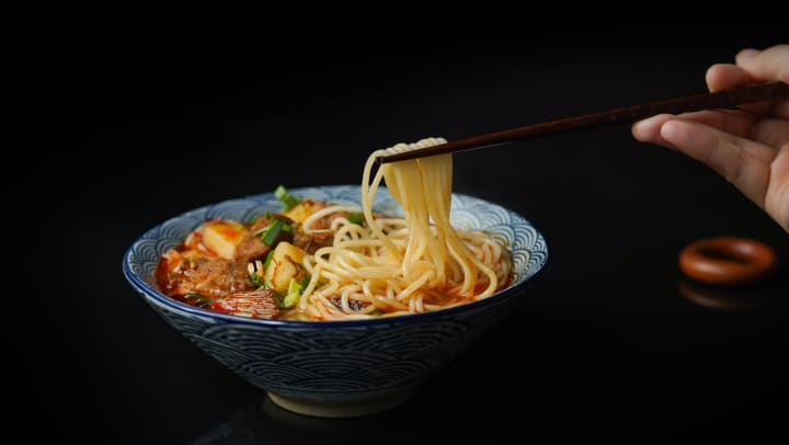 A bowl of Asian cuisine in a blog article on our website at Olympus Carrington in Pooler, Georgia.