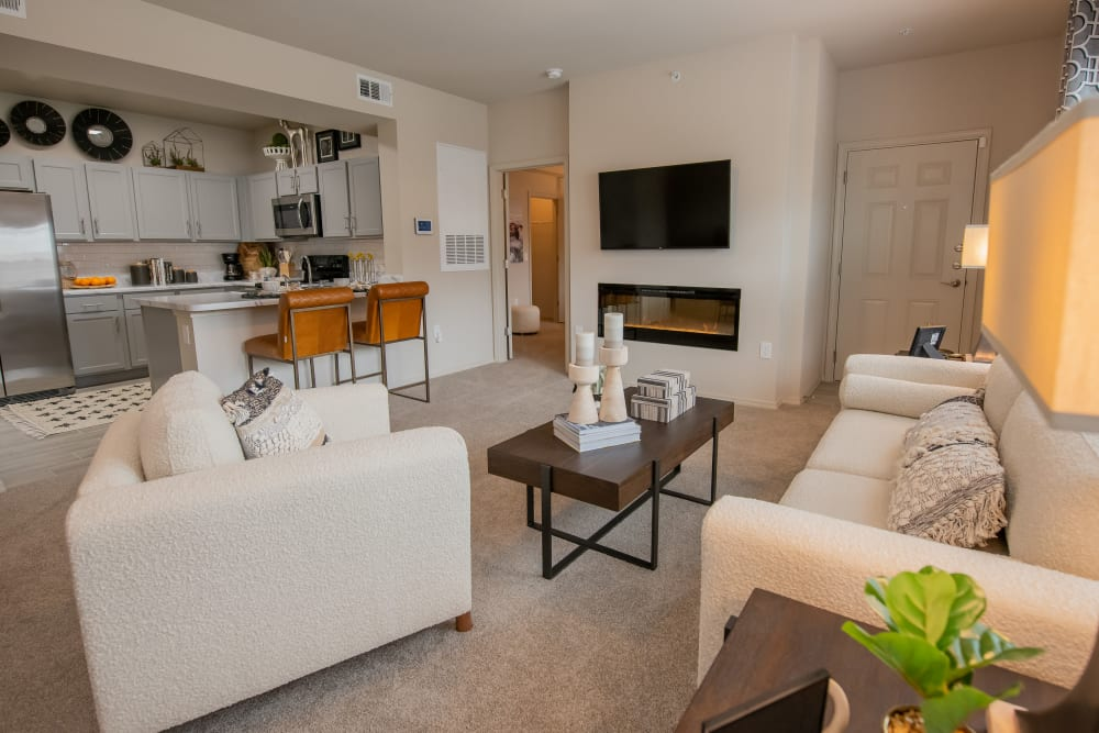 LED fireplace and open kitchen at Bend at New Road Apartments in Waco, Texas