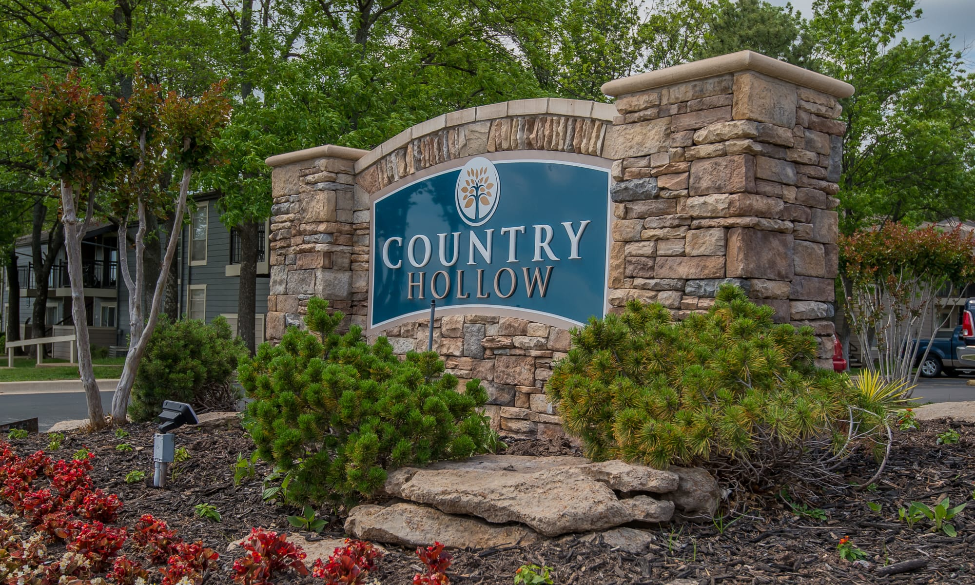 Welcome sign at Country Hollow apartments in Tulsa, Oklahoma