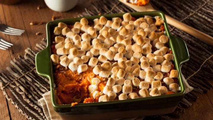 Sweet potato casserole with a layer of pecans and toasted marshmallows