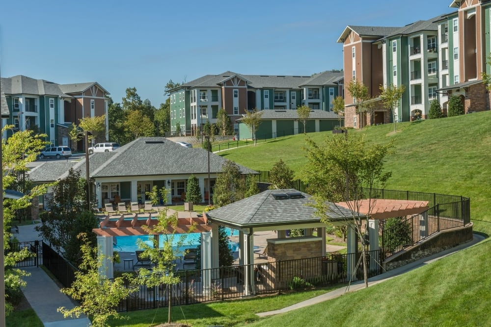 Sunny pool day at Integra Hills Preserve Apartments in Ooltewah, Tennessee