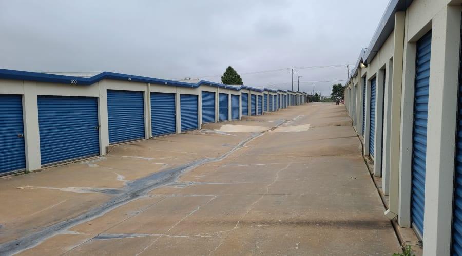 Exterior view of storage units with blue doors at KO Storage of Wichita Falls - North in Wichita Falls, Texas