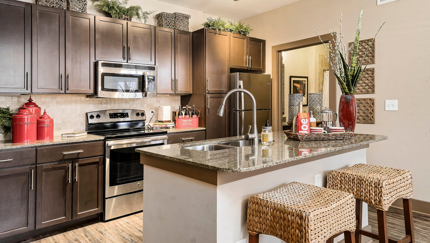 Stainless-steel appliances in a model apartment's kitchen at Sedona Ranch in Odessa, Texas