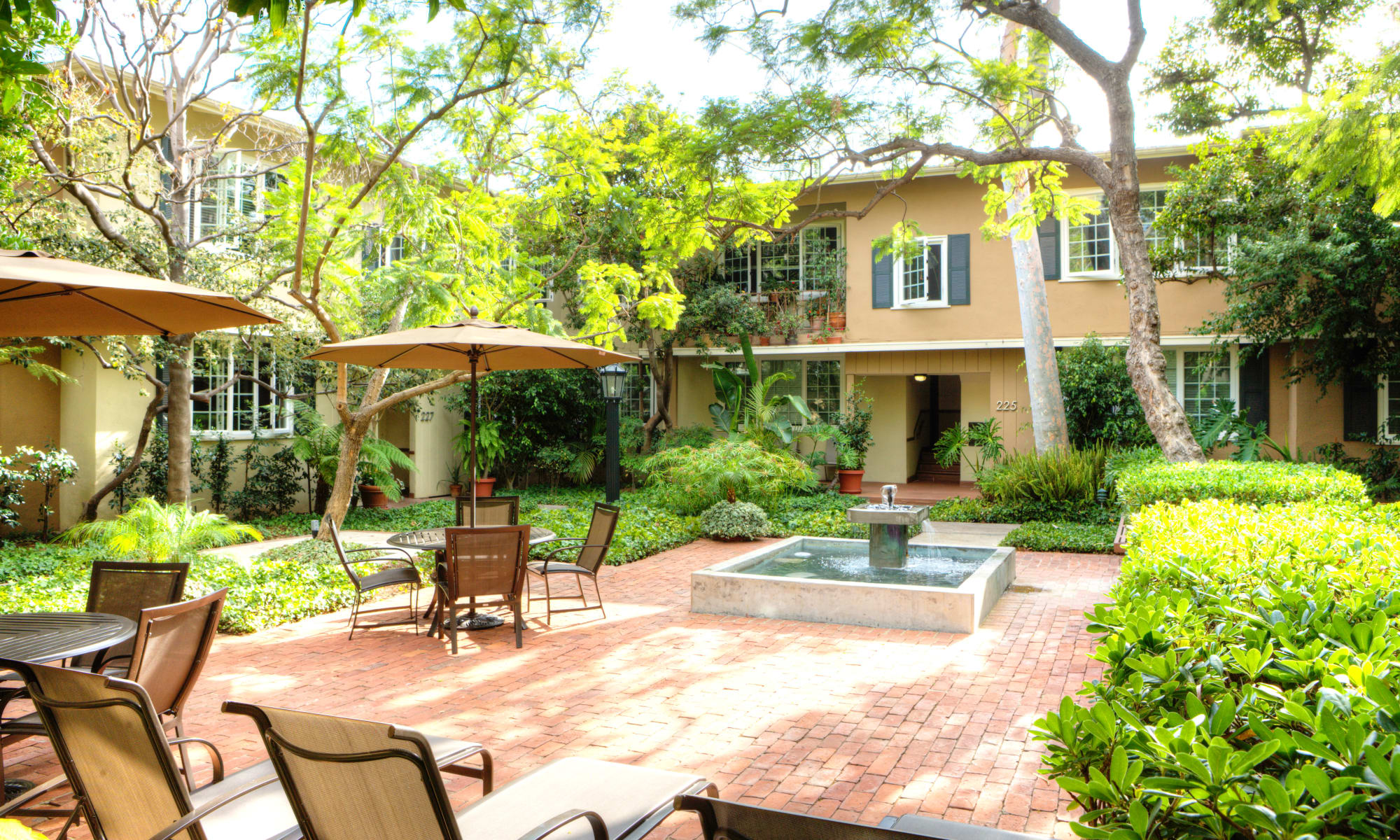 Beautiful courtyard with a fountain at West Park Village in Los Angeles, California