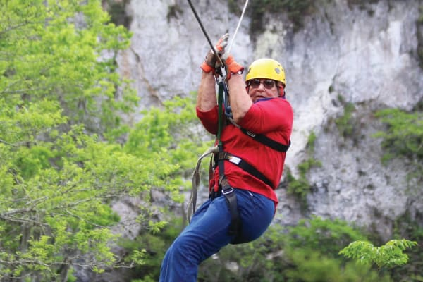 A resident from Heatherwood Gracious Retirement Living in Tewksbury, Massachusetts zip lining
