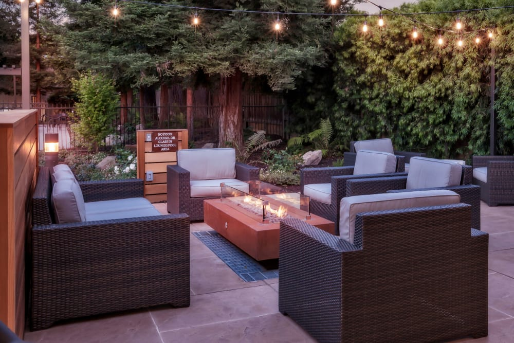 Outdoor lounge with a firepit at Brookdale Apartments in San Jose, California