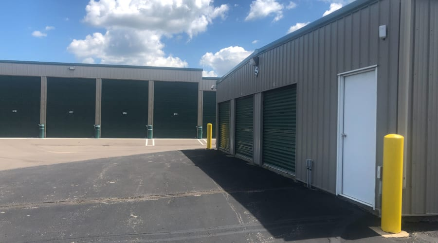 Exterior view of storage units with green doors at KO Storage of Clearwater in Clearwater, Minnesota
