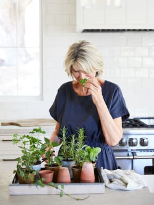 Woman smelling herbs at Avenida Partners, LLC in Newport Beach