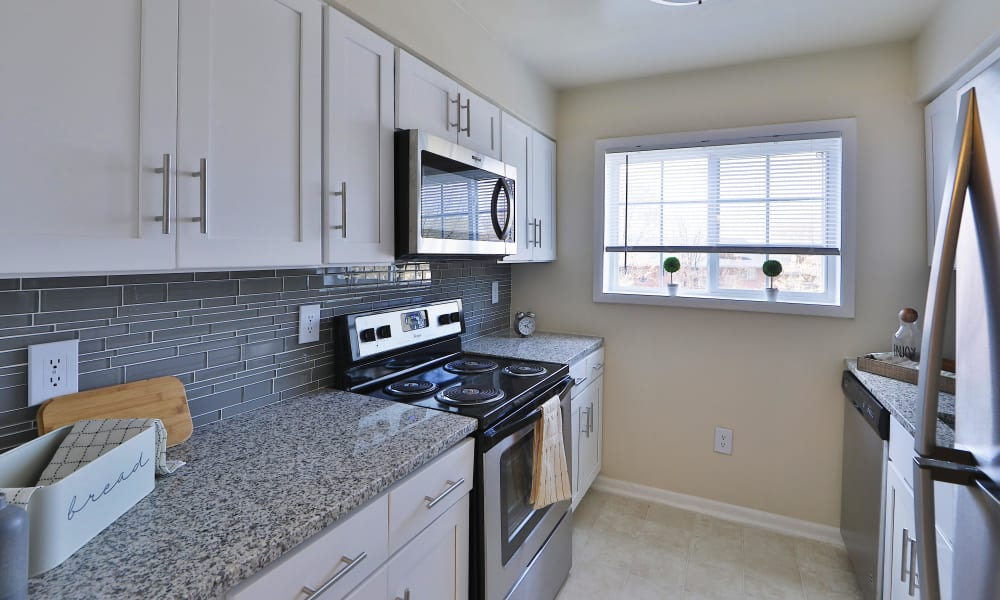 Bright Spacious Kitchen at The Meadows Apartments in Syracuse, New York