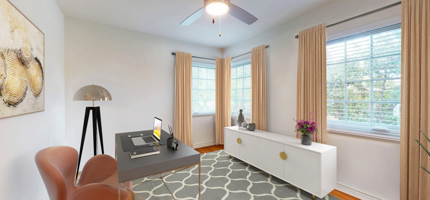 Comfortably furnished den in a model bungalow-style home at Sunset Barrington Gardens in Los Angeles, California