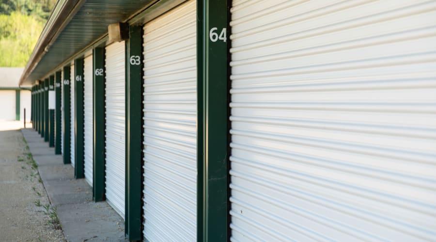 Storage units with white doors and locks at KO Storage of Knapp in Knapp, Wisconsin
