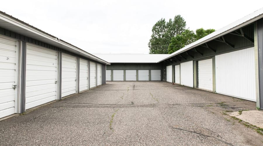 Storage units with white doors and locks at KO Storage of Maple Lake - Lumber in Maple Lake, Minnesota