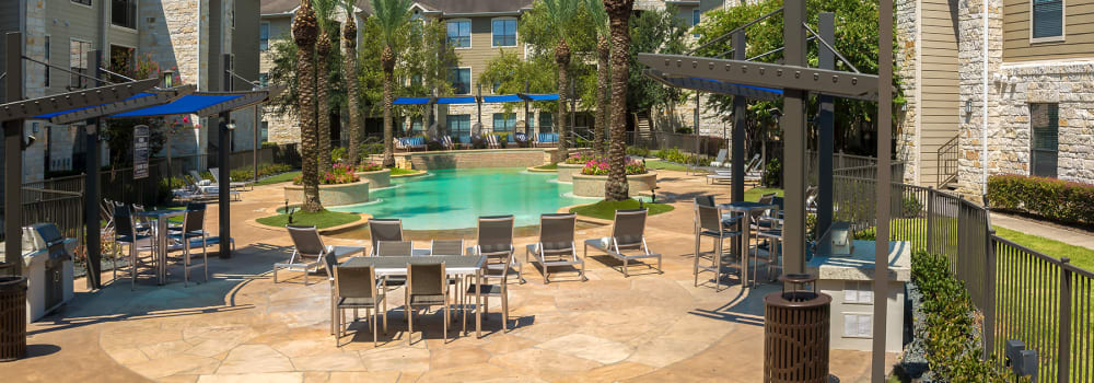 The sundeck with plenty of seating at Sommerall Station Apartments in Houston, Texas