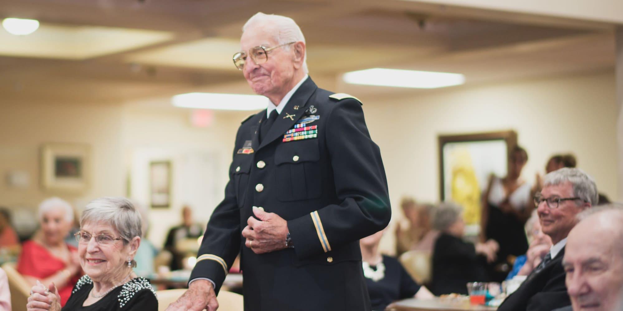 A veteran being recognized at Ashwood Meadows Gracious Retirement Living in Johns Creek, Georgia