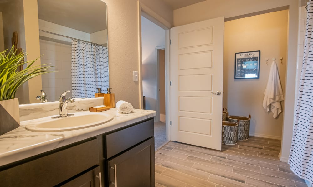 Bathroom with laundry room at Cottages at Crestview in Wichita, Kansas