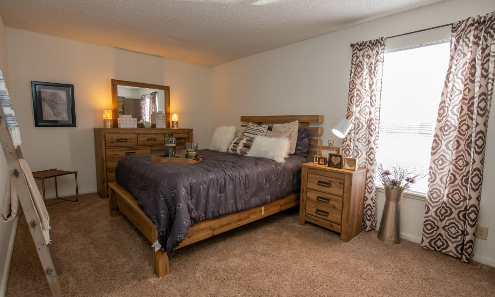 Spacious bedroom with window at Fox Run Apartments in Wichita, Kansas