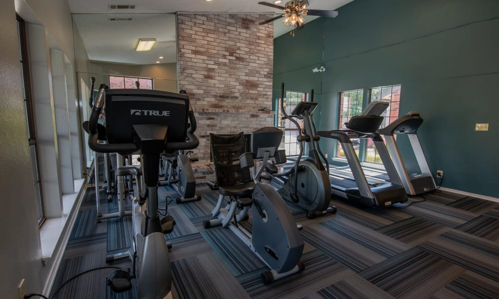 Fitness center with great lighting at Creekwood Apartments in Tulsa, Oklahoma