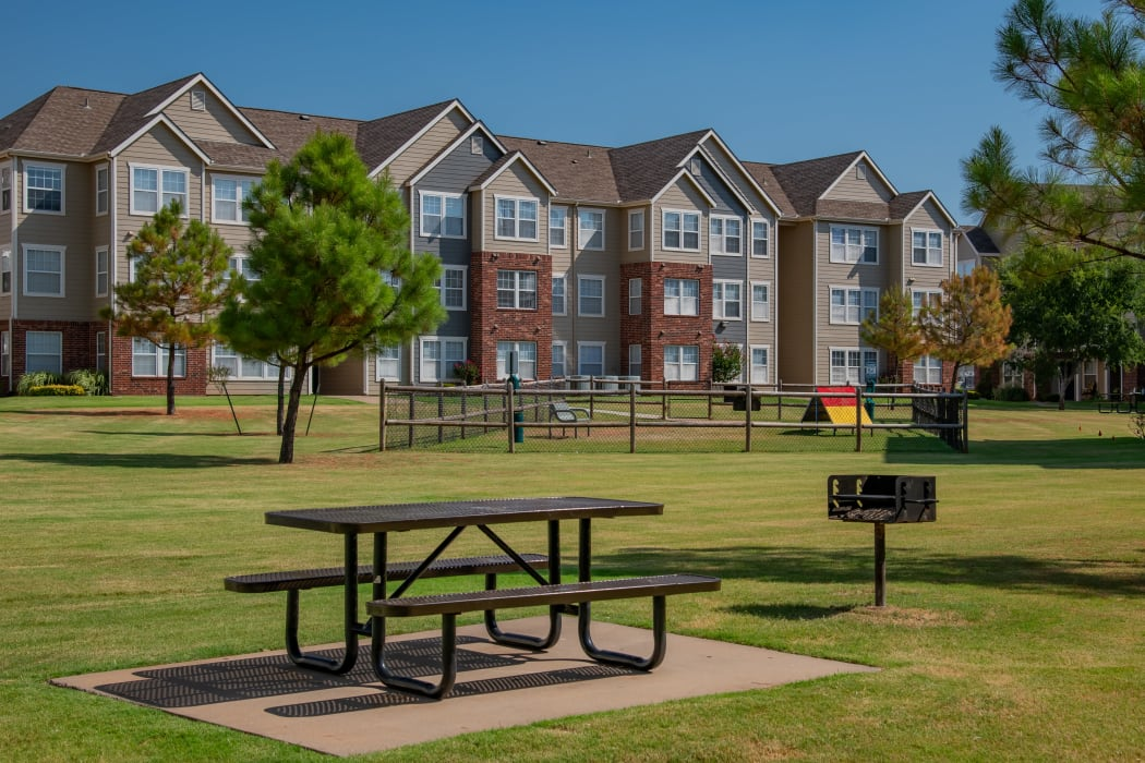 Outdoor courtyard and bark park at The Park on Westpointe in Yukon, Oklahoma