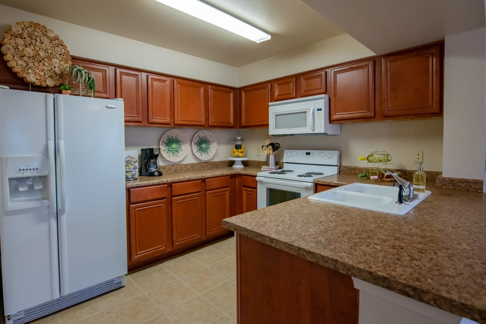 Cozy kitchen with appliances at Nickel Creek Apartments in Tulsa, Oklahoma