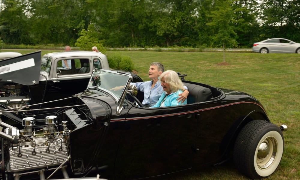 A couple in a classic car at Keystone Commons in Ludlow, Massachusetts