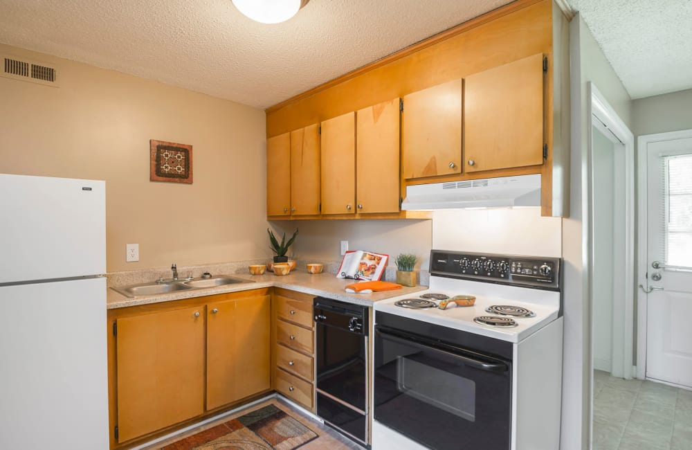 A kitchen with plenty of cabinetry at Lakewood Apartment Homes in Salisbury, North Carolina
