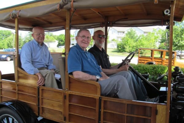 A group of residents in a wooden car at Guelph Lake Commons in Guelph, Ontario