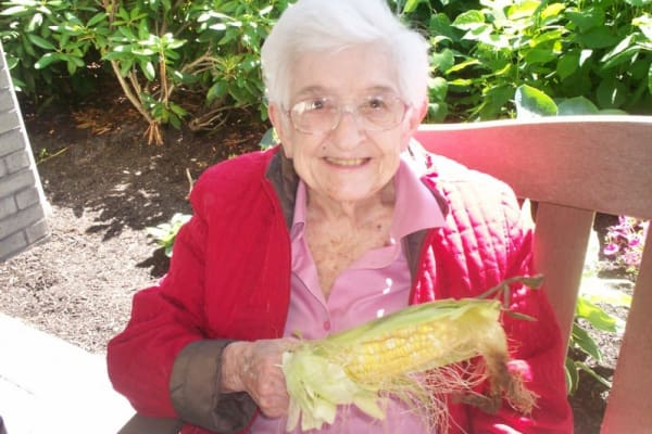 A resident holding corn at Magnolia Heights Gracious Retirement Living in Franklin, Massachusetts