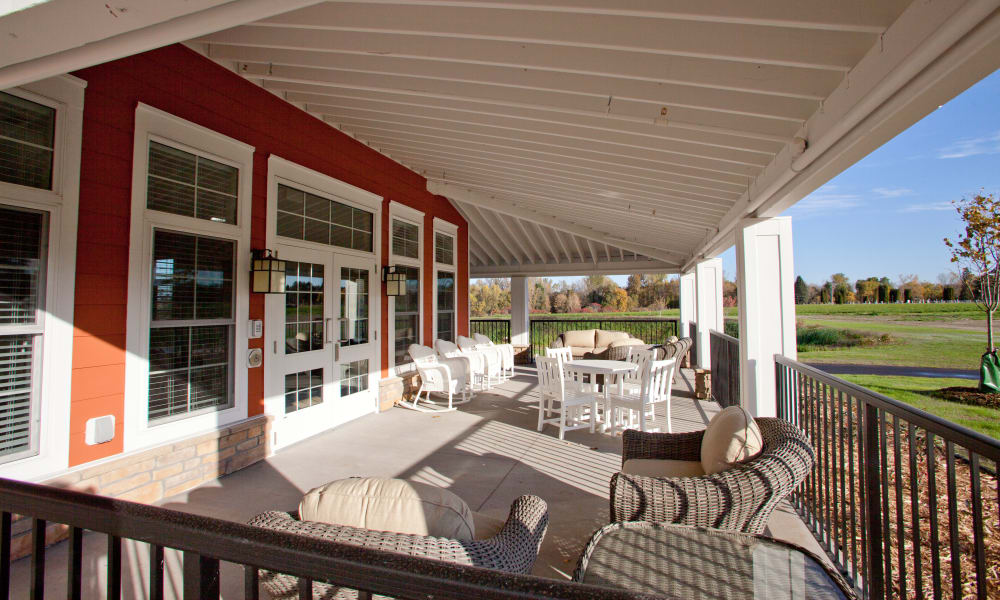 Covered patio seating at Keystone Place at Richland Creek in O'Fallon, Illinois