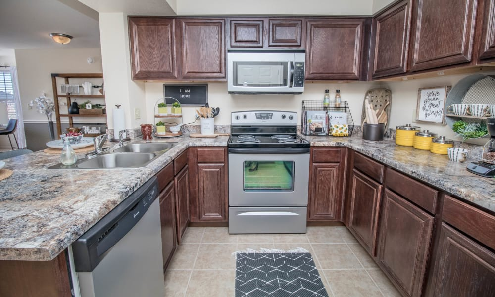 Bright kitchen with stainless appliances at Tuscany Place in Lubbock, Texas.