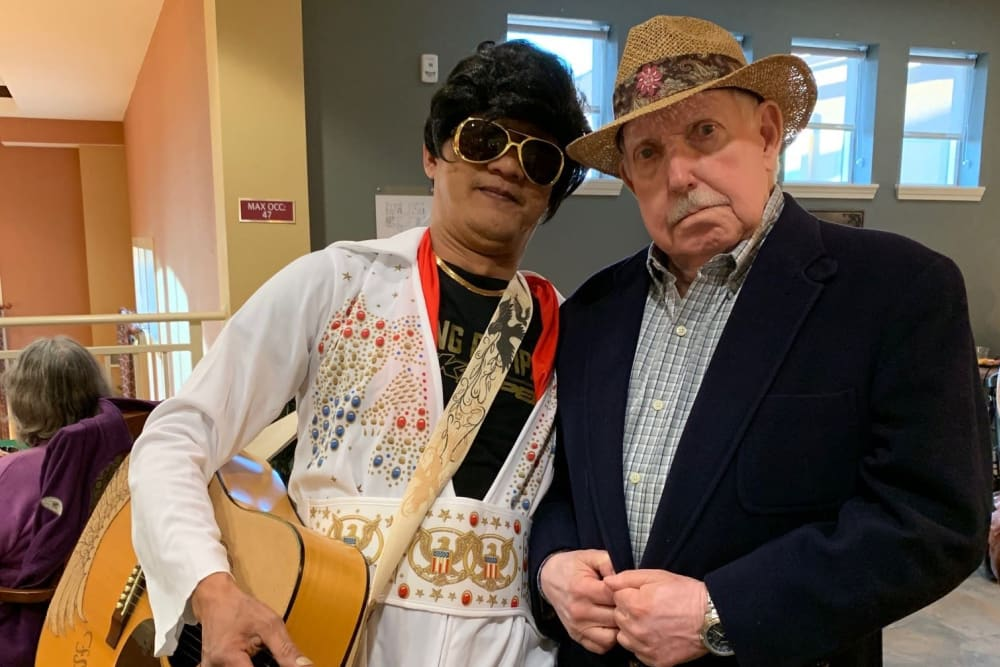 two senior residents at a costume party