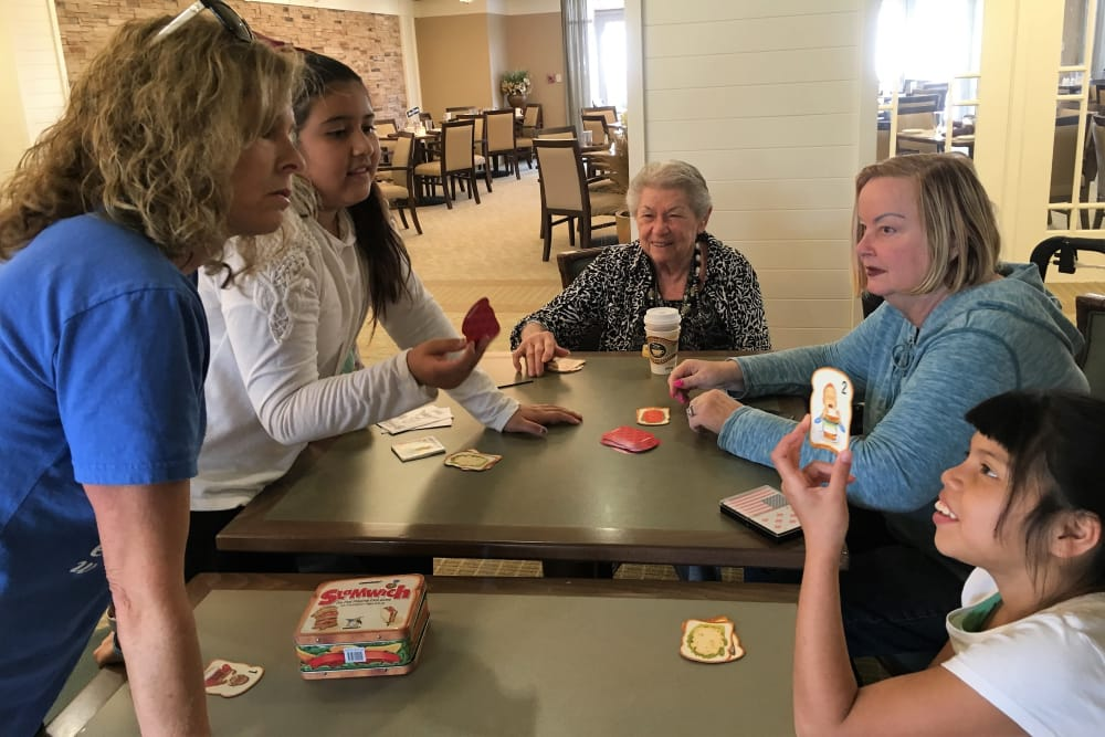 Residents playing with children at our senior living community