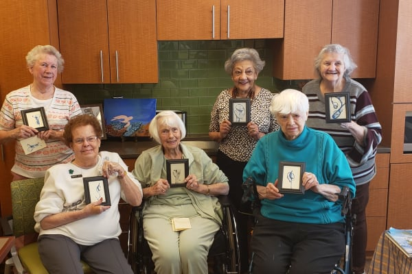 Residents with their paintings at All Seasons of Rochester Hills in Rochester Hills, Michigan