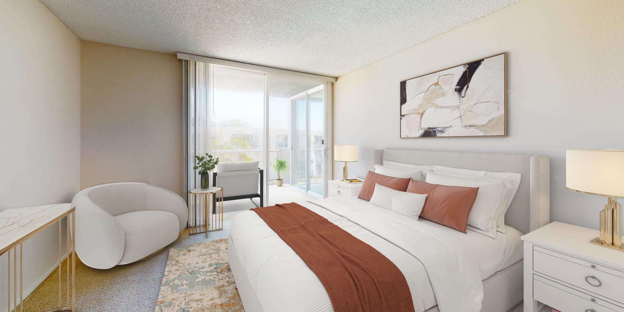 Spacious bedroom with a view of the marina at Waters Edge at Marina Harbor in Marina del Rey, California