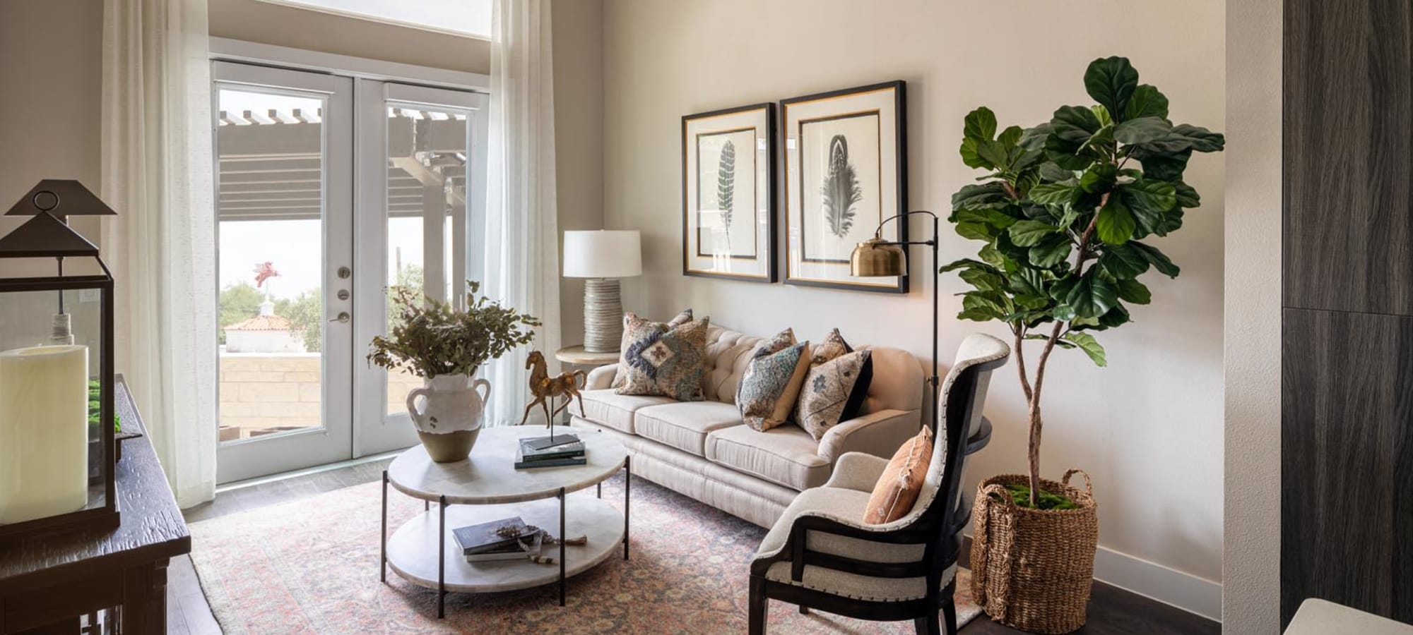 Classically furnished model home's living area at Magnolia Heights in San Antonio, Texas