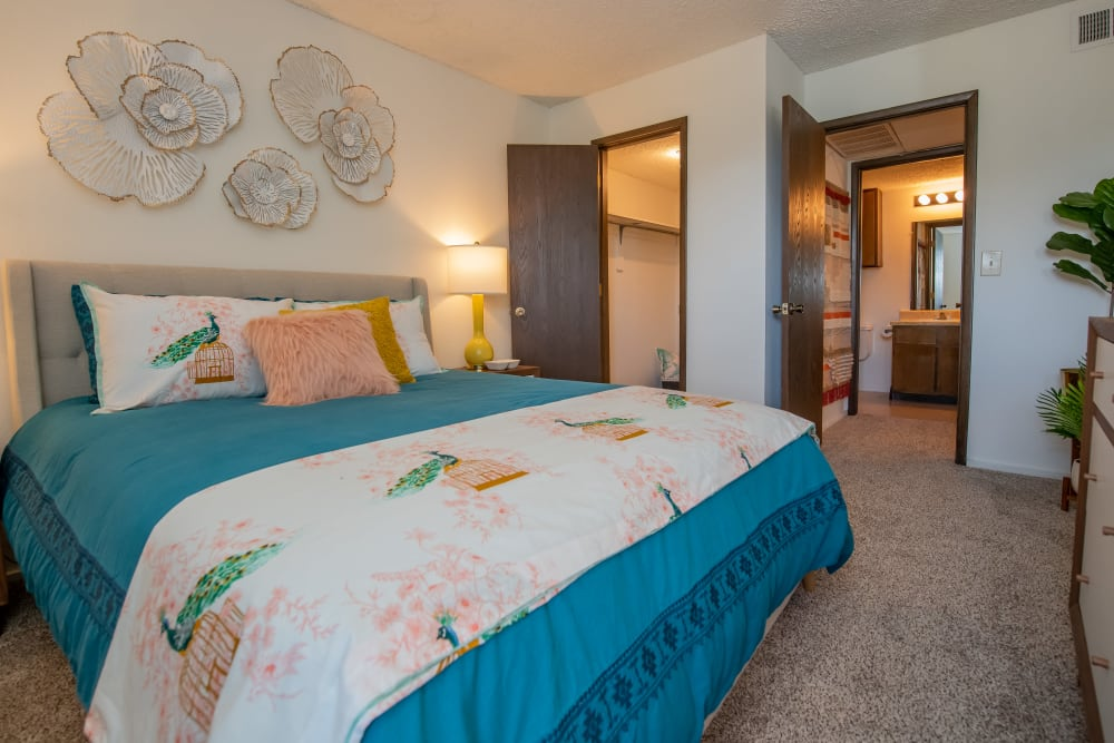 Spacious bedroom and closet with in-room bathroom at Fox Run Apartments in Wichita, Kansas