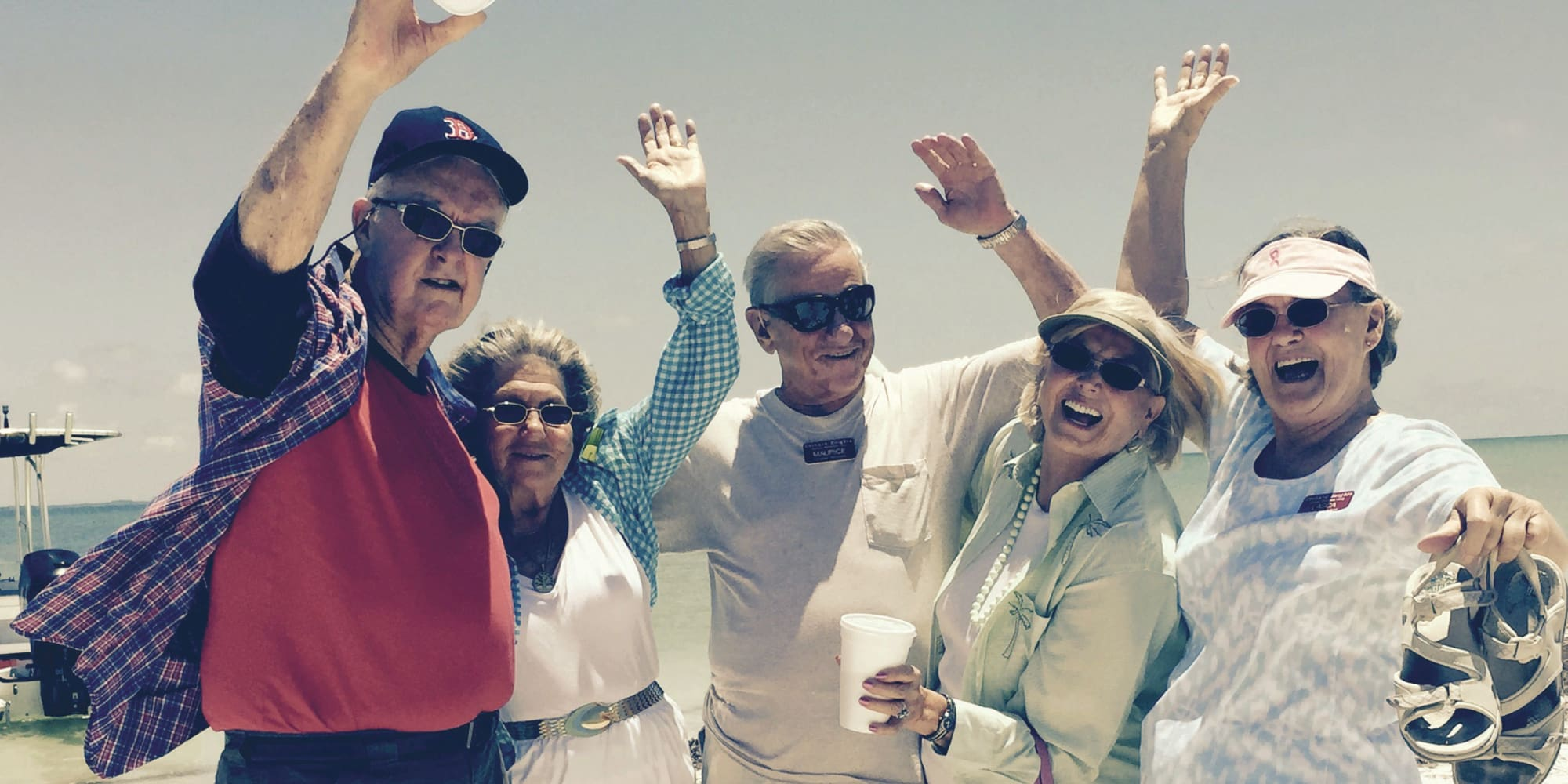 Residents from Magnolia Heights Gracious Retirement Living in Franklin, Massachusetts posing by the water