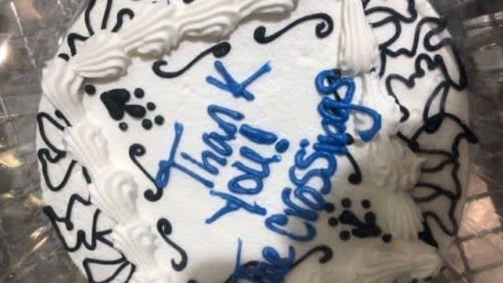 """A cake that says """"Thank you! The Crossings"""""""